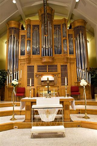 The sanctuary's chancel area, altar/communion table, and organ